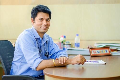 Dr. Girish M